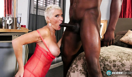Mature blonde drinks champagne after sex with a black man