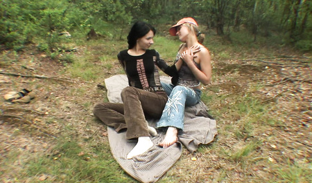 Beautiful girls engaged in group sex with Russian guys at a country picnic