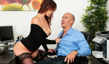 The new Secretary in stockings sucks cock of boss and has sex with him on the table in anticipation of the holiday
