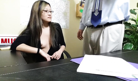 Young Asian girl sucks cock of boss and Fucks him on the desktop
