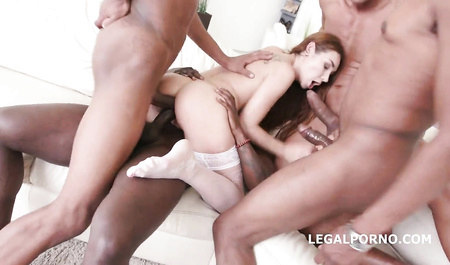 Cute redhead satisfies five blacks in rough Gangbang