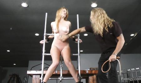 Pretty blonde forced to masturbate pussy artificial member