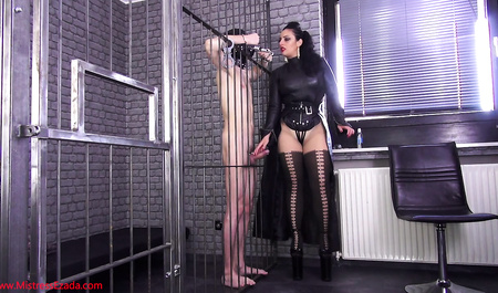Lady in black masturbating dick other through the cage