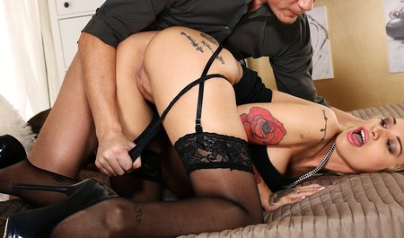 Guy banging a woman in the mouth and pussy, trying to insert a little deeper