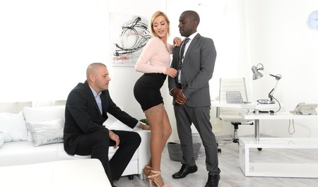Leggy business woman gets interracial sex from business partners in the office